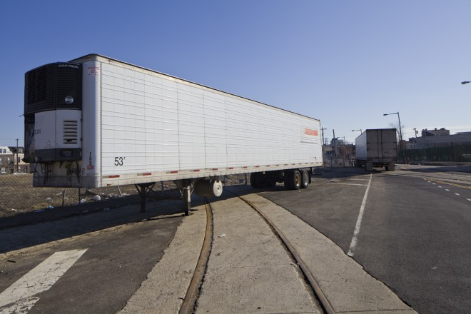 Trucks are frequently parked across the street from Emil's Gourmet, in front of Soko Lofts site.   Photo: Peter Woodall