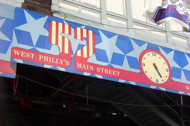Patriotic reminders of West Philly's Main Street, from before SEPTA's reconstruction of the el at 52nd Street station | Photo: Stephen Ives