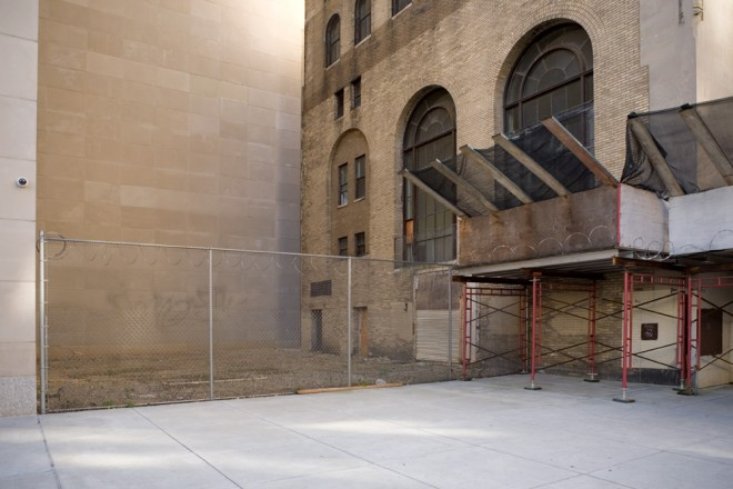 The two buildings Philadelphia Life Insurance Company once occupied—Adin Lacey's five-story 1915 Beaux-Arts original and Mitchell/Giurgola's 1962 addition—once stood here, where a blank wall of nothing is commemorated by a chain link fence | Photo: Bradley Maule