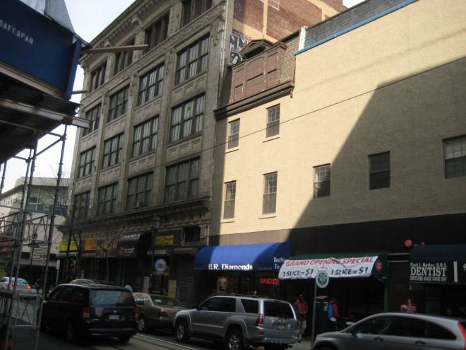 Current view of the first block of South 11th Street, site of the Downbeat Club. The club was on the second floor of 23 South 11th, what is now the E. R. Diamonds store, with the blue awning. Photo by Jack McCarthy