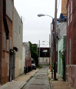 Wallace Street looking west from mid-block, looking towards the bridge overhead and the bend in the road. | Photo by Harry K.