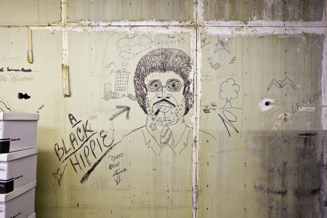 Worker graffiti. Notice a drawing of the Trans-Atlantic building to the left of the face | Photo: Peter Woodall