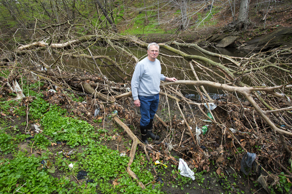 """""""UN-LITTER THIS: Retired environmental engineer Kelly O'Day at Tacony Creek, where litter from nearby streets washes into storm drains and, eventually, the creek itself."""" 