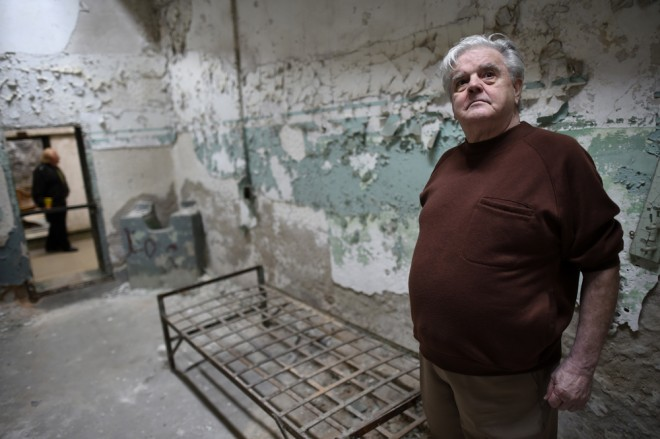 """""""Jimmy Dolan, 74, a former inmate Eastern State Penitentiary, who served a year and a half for robbery in 1961-2, returns to his cell in block 8, in Philadelphia, Pennsylvania April 30, 2014"""" 