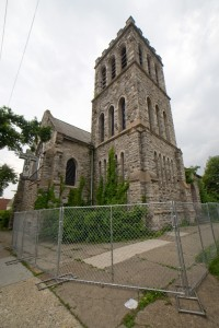 Unsecured chain link fence surrounds the tower at Church of the Atonement | Photo: Bradley Maule