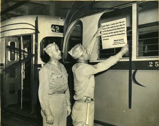 Soldiers putting sing on trolley indicating an end to the strike | Photo: Mayor's Office of Transportation and Utilities
