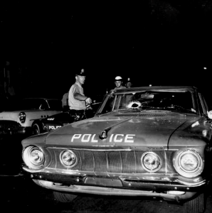 Police car damaged in riot