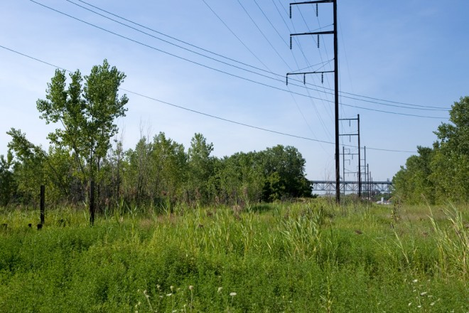 Catenaries mark the former route of the Kensington & Tacony Railroad, which will eventually be home to a trail along the Delaware   Photo: Bradley Maule