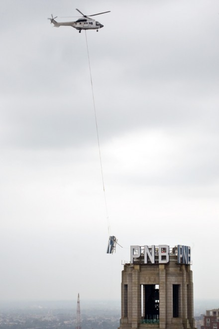 A helicopter takes the third letter, N, away from One South Broad, where it had resided for 58 years | Photo: Bradley Maule