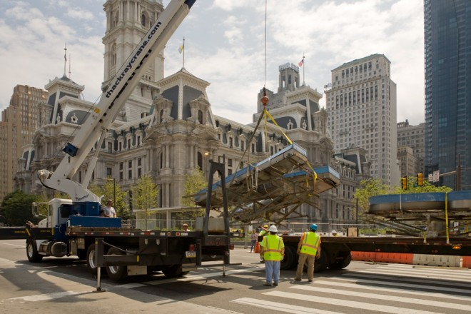 A crane hoists the N onto the truck, rejoining the P and B one last time | Photo: Bradley Maule
