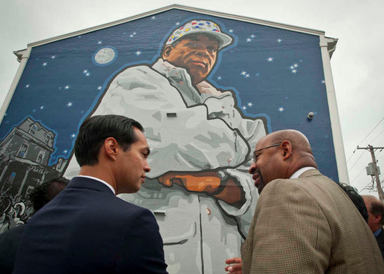 """Mayor Nutter explains the Mural Arts Program to HUD chief Julián Castro in front of the Herman Wrice mural."" 