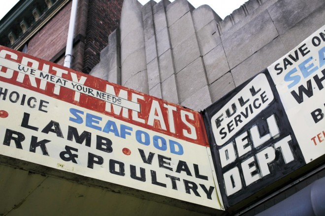 """Integrity Meats sign--""""WE MEAT YOUR NEEDS"""" 