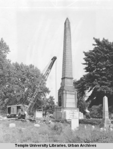 This photograph shows the removal of the monument of Monument Cemetery on June 6, 1956. | Temple University Urban Archives.