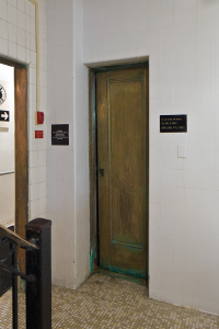 Copper door to the elevator.  A bit narrow by today's standards | Photo: Peter Woodall