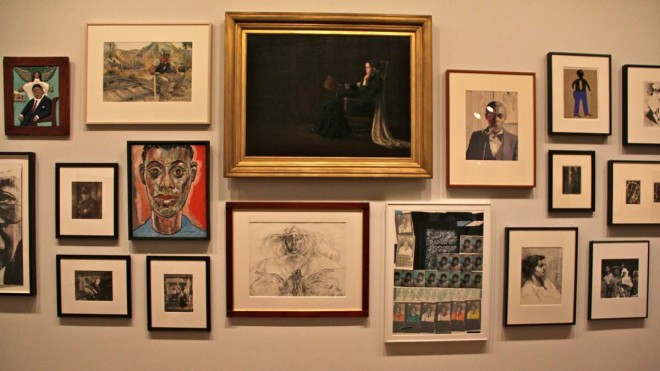 """A wall of portraits at the African American art exhibit at the Philadelphia Museum of Art includes Henry Ossawa Tanner's painting of his mother, 1897 (center, top). 