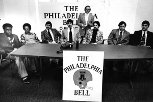 At their 220 South Broad Street offices, the Philadelphia Bell and Coach Ron Waller introduce players Rudy Sims, Ron Holliday, Pat McLaughlin, Bob Paschall, Mike Blandina, Frank McFillin and Ed Biernacki, April, 1974 |  Image courtesy of Temple University Special Collections Research Center
