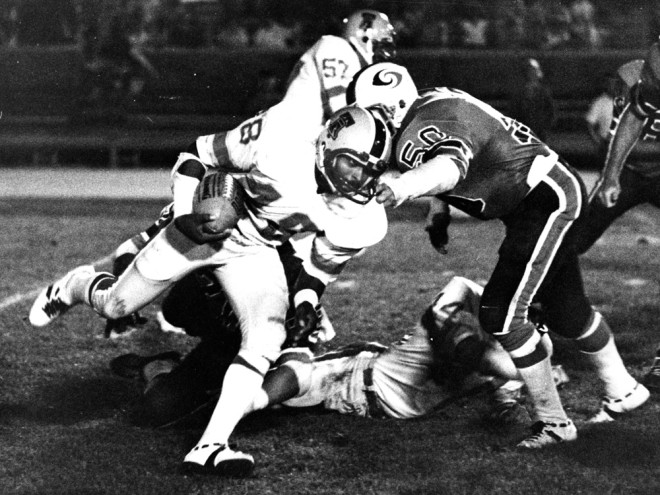 The Philadelphia Bell's Ron Mabra (48) runs past the Portland Storm's Bob Schmidt,  July 11, 1974 |  Image courtesy of Temple University Special Collections Research Center