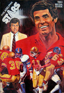 Head coach Jim Mora and GM Carl Peterson watch over their Philadelphia Stars on the cover of this 1983 media guide