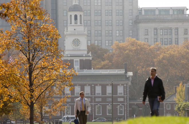 """People walk on an Autumn day in view of Independence Hall on Wednesday, Nov. 12, 2014, in Philadelphia."" 