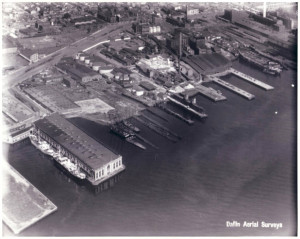Baugh & Sons' empire of bones from above: theirs is the low-lying dark complex with a tall smokestack on the upper right. Note the Port Authority's still-extant Pier 78 at lower left | Photo: Dallin Aerial Survey Company via Hagley Library