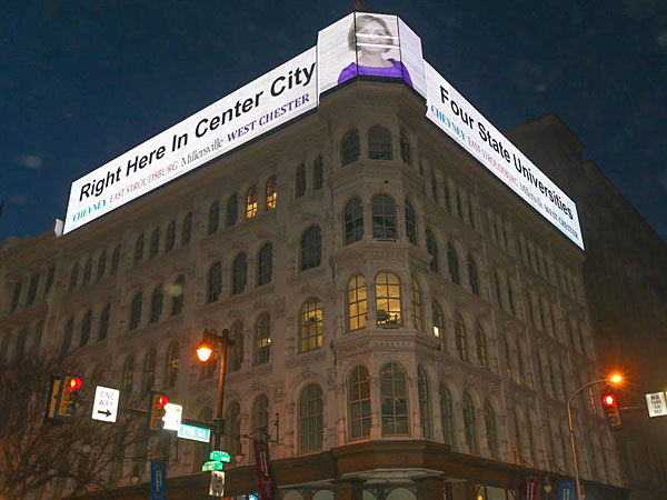 """""""A digital sign installed on the historic Lit Bros. building in January. A half-dozen more are planned between Seventh and 13th Streets."""" 