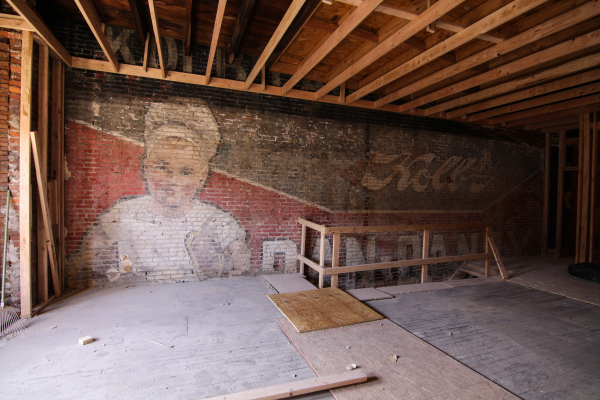 The ghost sign will be treated and re-covered. | Photo: Conrad Benner