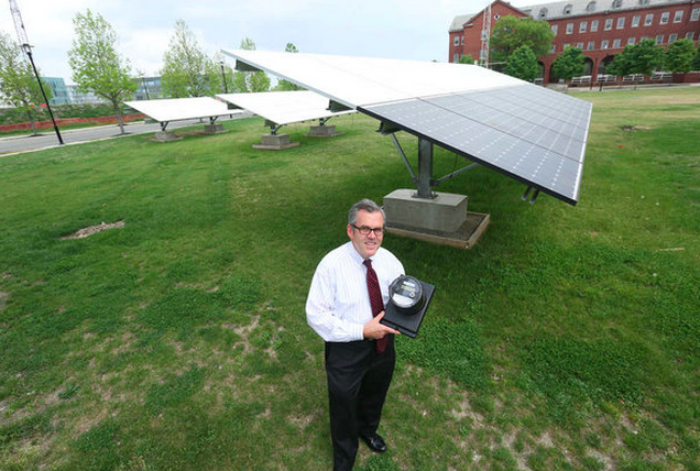 """Will Agate holds a smart meter at the Navy Yard. Developers have chosen Landis & Gyr AG to install the grid system."" 
