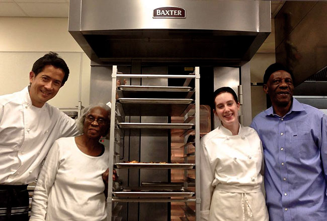 "David Wong (left) , co-founder ""FRIEDA for generations"" with cross-generational cooking team at Dorrance H Hamilton Center for Culinary Enterprises"