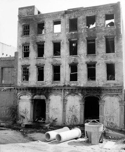 The rear façade of the Brock Stores after the 1977 fires that completely destroyed the building just before demolition   Photo: HABS Collection, Library of Congress