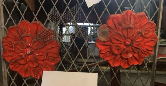 On the right, a cast iron rosette once on the rear façade of the Brock Stores, currently in the possession of Alan Johnson. On the left is a plaster mould of a rosette made by Alley Friends Associates. A small magnet is on the metal piece   Photograph by author