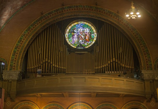 Pipe organ and stained glass depicting St. Cecelia | Photo: Dan Papa