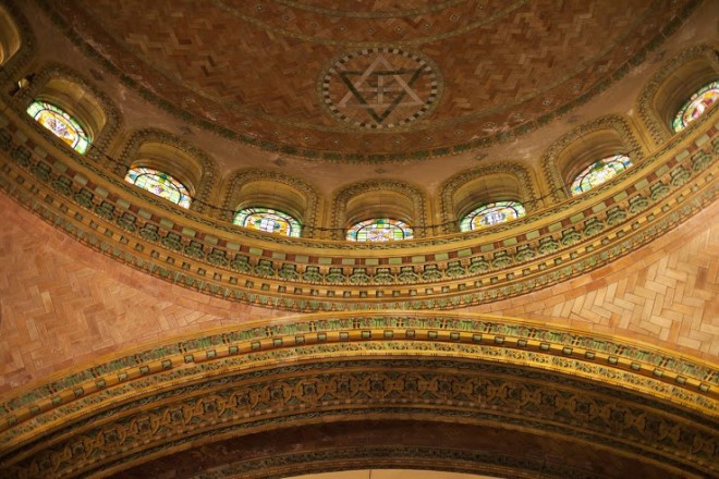 The base of the dome with stained glass and terra cotta arches.