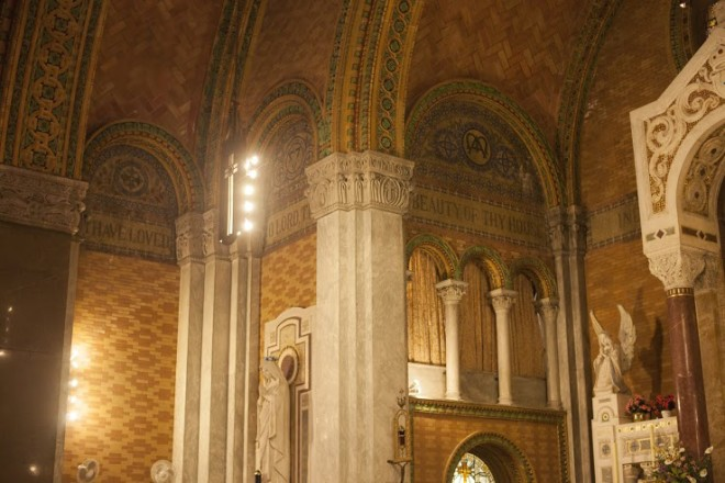 Terra cotta and mosaic details behind the altar