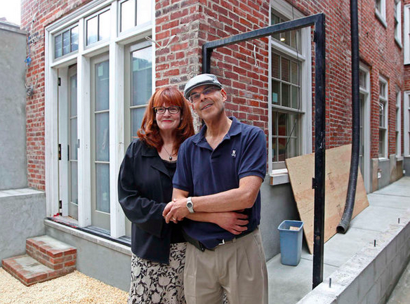 Terri and Mark Steinberg outside their new home in Fitler Square } Photo: Michael Bryant, for The Inquirer