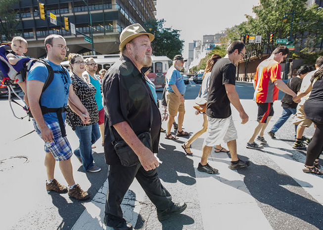 """""""Edward A. Mauger, tour guide and author of four books on the city's history, walks toward the Independence Visitors Center"""" 
