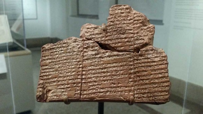 """An ancient clay tablet marked with cuneiform, a written language unique to ancient Mesopotamia, on display at Penn Museum"" 