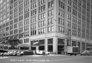 "The northwest (Broad and Noble) corner of the Terminal Commerce Building in 1955. The old Reading diner car #1186 has yet to be parked (and forgotten) alongside the building. The ""Steak and Bagel car"" started life as a luxury dining car on the Reading Railroad's Iron Horse Rambles after being built in 1922. The railroad sold the railcar in the 1970s and diner food has been intermittently served inside since then. The tracks on which it rests are no longer connected to working rail, so the car is pretty much stranded there. 