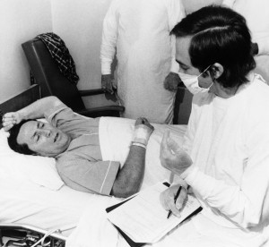 Center for Disease Control epidemiologist Stephen Thacker interviews Thomas Payne at Chambersburg Hospital on Aug. 4, 1976. Payne's temperature rose to 107 degrees after contracting the bacteria | Photo: Public Domain