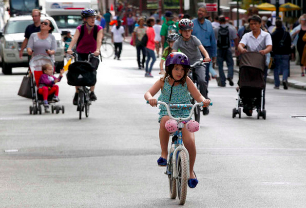 """Traffics bans for Pope Francis' visit brought cyclists out on Third Street."" 