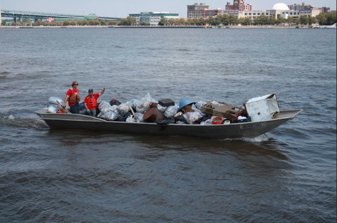Two volunteers with the nonprofit Living Lands and Water participate in an August cleaning of the Delaware River, which collected some 16 tons of garbage