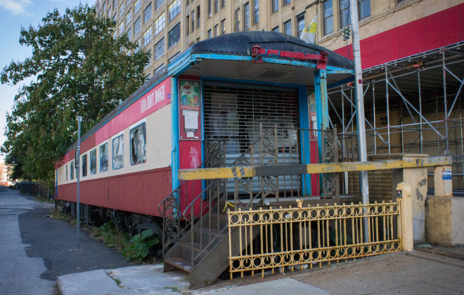 "The old Reading diner car #1186 has yet to be parked (and forgotten) alongside the building. The ""Steak and Bagel car"" started life as a luxury dining car on the Reading Railroad's Iron Horse Rambles after being built in 1922. The railroad sold the railcar in the 1970s and diner food has been intermittently served inside since then. The tracks on which it rests are no longer connected to working rail, so the car is pretty much stranded there. 