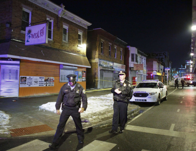 Police investigate a fatal shooting at 53rd and Market streets in February 2014."