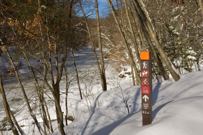 Friends of the Wissahickon's new trail posts stand out in the snow