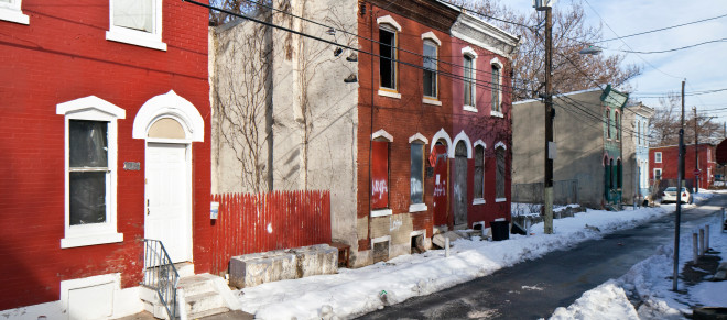 Will PHA rehab small rowhouses like these on the 2400 block of Harlan Street and build new homes as infill, or tear them down and eliminate small through streets to create larger parcels for new residential construction? Mum's the word from PHA so far | Photo: Peter Woodall