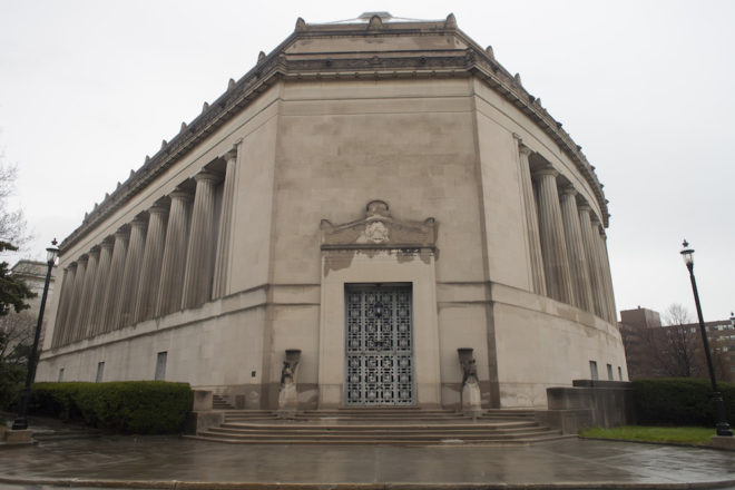 The brushed aluminum doors and carved pediment of Girard College Chapel   Photo: Dan Papa