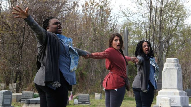 Performers of Renegade Theater Company's rendition of Beowulf rehearse among the tombstones of Mount Moriah Cemetery in Southwest Philadelphia. | Photo: Emma Lee, for NewsWorks