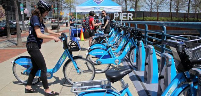 An Indego user returns a bike to a dock. | Photo: Emma Lee, for NewsWorks
