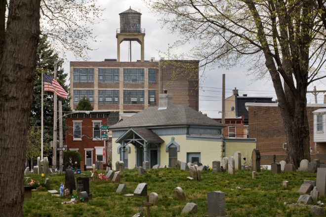 Palmer Cemetery, looking toward historic gatehouse; former Brownhill & Kramer Hosiery Mill stands at rear | Photo: Bradley Maule
