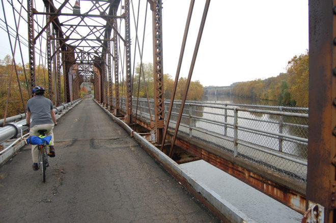 A cyclist rides on the Pencoyd Bridge, which, come autumn, will carry the Pencoyd Trail from Manayunk to Lower Merion Township, Montgomery County. | Photo: Bicycle Coalition of Greater Philadelphia
