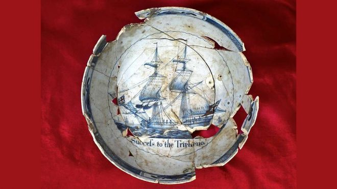 "A reassembled commemorative punch bowl, wishing ''Success to the Tryphena,"" a merchant ship on which sailed Philadelphians' petition against the Stamp Act duties, c. 1765. (Commonwealth Heritage Group, Inc.)"